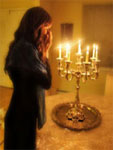 An Agunah lighting her Shabbas Candles & hoping to receive a Jewish Divorce