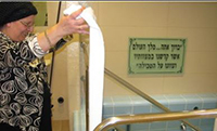 A mikvah attendant making sure the mikvah is clean