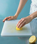 Woman cleaning her cutting board